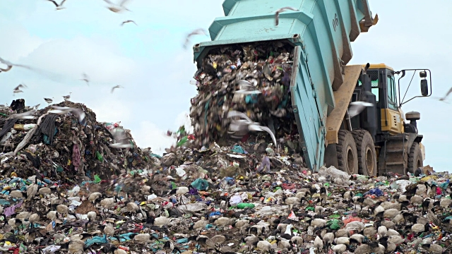 trash filling a landfill site